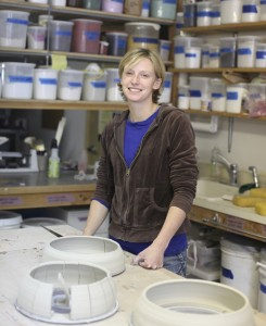 Julie Anderson in her studio creating glaze test tiles in 2012